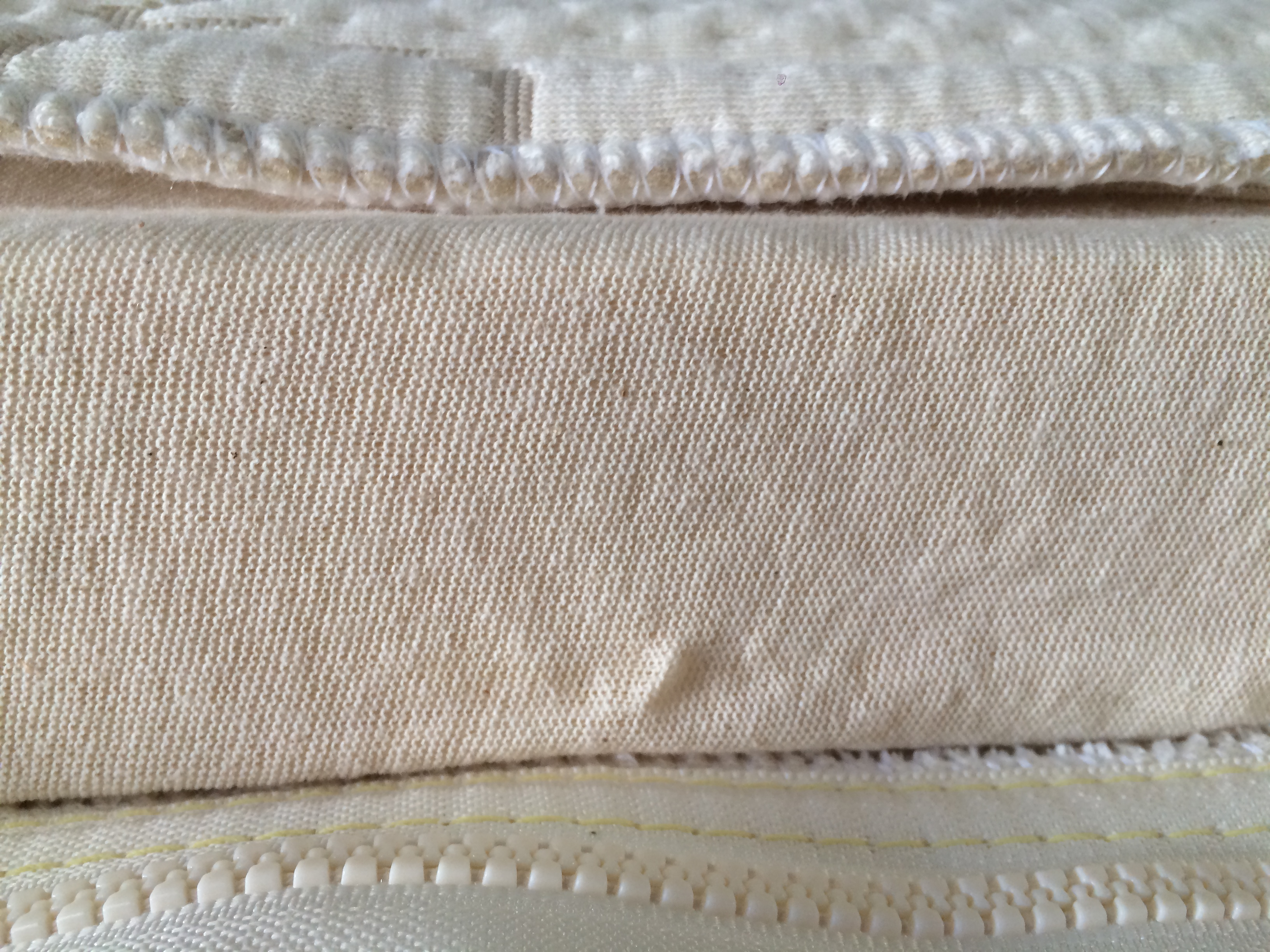 we cover each piece latex bedding piece in a certified organic cotton knit sock